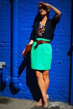 This teal colored skirt is sooooo great!  And I love her chunky necklace.