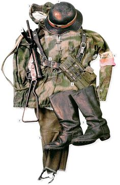 """Soldier of the Warsaw Uprising, 1944 01 German """"Gladiator"""" helmet 02 Wehrmacht sweatshirt in """"Sumpftarnmuster"""" camp 03 Polish main belt 04 Polish breeches 05 German boots 06 Ak (Home Army) armband 07 9 mm Sten Mk II SMG 08 German ammo pouches for mags"""