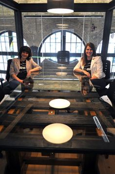 Ellipsis Digital employees Rachel Berdan, VP customer engagement (left), and Karen Schulman Dupuis, VP business design, sit at their railway-inspired conference table in London Ont. April 22, 2015. Ellipsis Digital opened up their renovated space in the historic London Roundhouse to the public that day. CHRIS MONTANINI\LONDONER\POSTMEDIA NETWORK