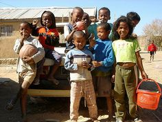 MADAGASCAR: Kids playing on a car at the edge of Ilakaka, Madagascar, scene of the most intense gem rush in modern history. In 1998 locals found pink sapphires lying on the ground, and within two years at least 100,000 Malagasy descended on the area.