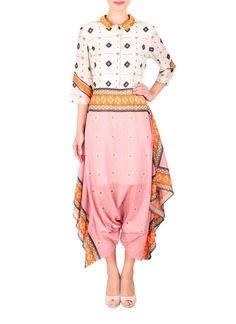 Geometric patterns and tribal-inspired prints combine to make this cotton silk dhoti jumpsuit from Sougat Paul perfect for the modern woman with a penchant for traditional style. With three quarter length sleeves and a button front bodice, this jumpsuit features a two-tone look with draped accents and relaxed pants that create a chic silhouette.