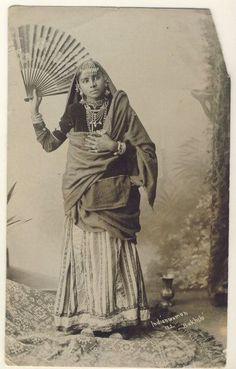 Studio Portrait of an Indian Woman with Fan - c1910's