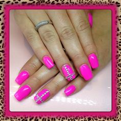 Pink acrylic nails with rinestone's