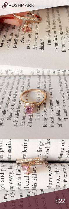 NEW! Pink Zircon Dangle Gold Ring Pink Zircon Dangled Gold Ring. Small stones encrusted on the band. Not real gold but quality ring. Jewelry Rings