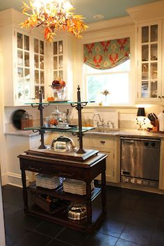 My kitchen isn't much larger than this... I love the glass front cabinets. courtesy of Mary Carol Garrity