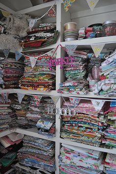 Sewing room. Um yes please!!! Love the fabric stash :)