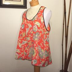 "Bright and Cheerful Loose Fit Top Features a slight racer back, slight high-low hem and cute contrast binding. Label says small but measurements are more M-L in my opinion so I have marked it as such. Fun blouse, just doesn't fit me   Bust: 42"" Length: 25""-27"" Sweet Rain Tops Tank Tops"