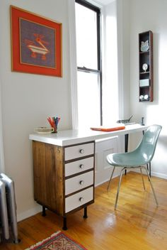 Desk is long and narrow, so it doesn't occupy a lot of room but makes the most of the space by the window. The left part of the desk is a renovated vintage nightstand that was stained and its hardware changed. All drawers and the tabletop were painted in white. The tabletop is made of two pieces of 3/4″ MDF.