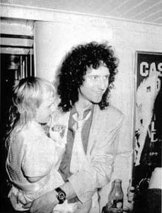 Brian May with his daughter Louisa in Montreux, Switzerland, 1986.