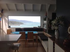 View of Lyall Bay over dining table, with bench seat storage and newly upholstered seat and back