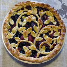 Creative Ways To Top Your Pies (PHOTOS) Winding Vines Pie  This triple-berry pie is beautifully decorated with a garden design made entirely out of dough. Some handy cutting and flower- and leaf-shaped cookie cutters are that you need to achieve the look.
