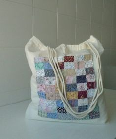 #DecorativeBags, #Memories, #Quilting, #RecycledCloth, #Sewing, #UpcycledCloth This Scrap Cloth Cotton Bag was made by upcycling scraps of pretty cloth and creating a mini quilt on a simple drawstring cotton sack. You can use fabric glue, hand-stitch, or sew it all in place. This features a square pattern, but crazy-quilt