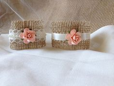 Peach Rose and Burlap Napkin holders.  Unique way to add more flare to your reception table.   Etsy listing at https://www.etsy.com/listing/200985219/peach-wedding-napkin-rings-wedding-table