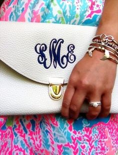 White leather clutch with embroidered initials
