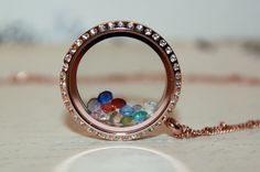 New in Stock! Rose Gold Floating Locket with Crystals. Only $25 with matching Ball Station Chain!