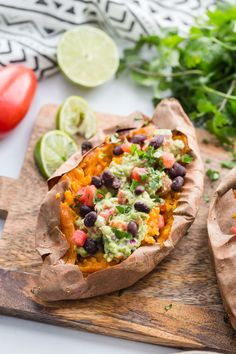 Guacamole Stuffed Sweet Potatoes- these are simple to make and a great vegan dinner option! You can serve these as a side dish or even eat them as your main course.