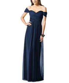 Dessy Collection 2844 is a full length, off the shoulder, sweetheart neckline bridesmaid dress with a criss cross ruched bodice, shirred skirt, and a hidden zipper in back. Style 2844 is made of lux chiffon.