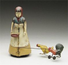 Early hand-painted wind up woman feeding chickens, c. 1900, Germany
