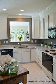 Would definitely do a kitchen remodel!  We would knock out a wall to create more space, replace cabinets and counters and such...