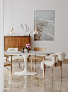 Just love this dining room, simple and stylish with the two mega gold pendants hanging over this simple dining table! Modern classic designs at their best!
