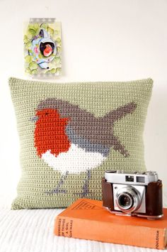 Crochet your own Robin Cushion! Inspired by woodland animals and the English countryside, this cushion is great to make with full instructions. Includes colour change chart and photos to guide you through making this delightful cushion. With a buttoned opening on the back to take the