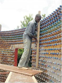 In Africa, empty plastic bottles become homes: the house is made from capped, sandfilled plastic bottles, each weighing three kilograms. The bottles are stacked into layers and tied together with an intricate network of strings holding each bottle by its neck to provide extra support and flexibility. Then the structure is bonded together by mud and cement. Bottle caps of various colours protrude from the walls, giving them a unique look. Those behind the project claim the sand-filled bottles…