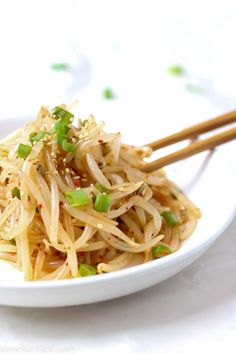 This simple 10 minute Korean bean sprout salad is fresh crunchy and addicting Toss them into a stir fry enjoy it as a side dish mix into a salad or eat it as is No matter. Bean Sprout Salad, Bean Sprout Recipes, Sprouts Salad, Korean Bean Sprouts Recipe, Stir Fry Bean Sprouts, Korean Side Dishes, Easy Korean Recipes, Asian Recipes, Ethnic Recipes