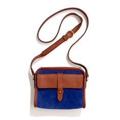 "the camden bag in suede  $118.00  Item# 11672  Inspired by the utilitarian shape of old-school camera bags, this cross-body bag in softest suede is picture perfect.  Suede.  Zip closure.  Front pocket with collar stud closure, interior pocket.  49 1/2"" adjustable shoulder strap.  5 1/2""H x 7""W x 2 3/4""D.  Import."