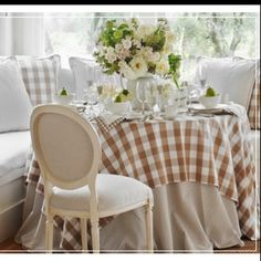 Checkered table cloth in a soft, romantic dining space