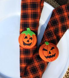 Adorable jack-o-latern napkin rings make a festive Halloween place setting!