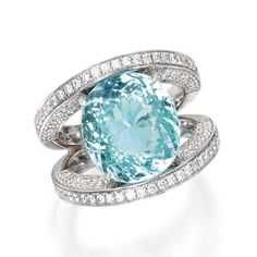 From Sotheby's | 18 Karat White Gold, Paraiba Tourmaline and Diamond Ring. Centering a cushion-cut paraiba tourmaline weighing 8.94 carats, the mounting set with round diamonds weighing 1.76 carats, size 6¼. | Cushion Cut, Round Diamonds, Auction, White Gold, Engagement Rings, Jewels, Amazing, Enagement Rings, Wedding Rings