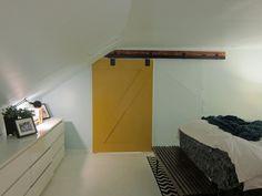yellow barn door in attic
