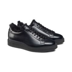 Trending elegance for this all-black sneaker in polished calfskin with a fur lining. Outfitted with a micro sole and a rubber tread in a matching colour, this piece of footwear delivers both enhanced traction and incredible lightness. Luxury Shoes, Online Boutiques, All Black Sneakers, Hiking Boots, Men's Shoes, Footwear, Fur, Colour, Leather