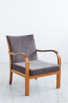 A pair of fruitwood framed armchairs with curved arms on square straight legs, newly upholstered in mushroom velvet. Seat cushions detachable.  Explore interior design inspiration and shop vintage furniture, antique furniture, contemporary furniture and mid-century designs.