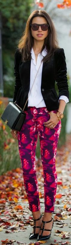 Love this look. Floral ankle pants, suede blazer black studded heels and a simple white button down with sunglasses and a clutch as completer pieces. (MVR)