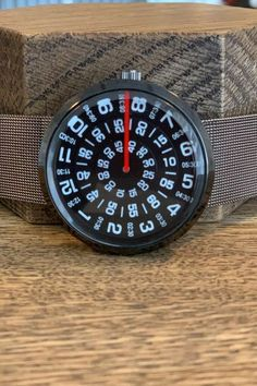 This is the coolest watch you'll ever lay eyes on! Not only is the design aesthetically pleasing with its black face and gunmetal grey case and strap, but it's also unique and practical. Unlike most watches, this quartz one features 1 red stationary hand and the 3 number dials rotate instead to indicate the time. #trendhim #menstyle #urbanstyle #watch #menswatch #uniquewatch #metalwatch
