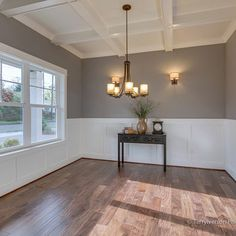 Beautiful room! Pewter Tankard- Sherwin Williams - love the color, box-beam ceiling and the wainscoting.
