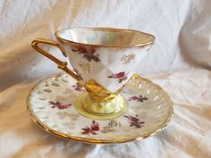 Very nice Royal Sealy footed Tea cup and saucer iridescent gold trim and pink flowers by JasonsCollectables on Etsy https://www.etsy.com/ca/listing/399350019/very-nice-royal-sealy-footed-tea-cup-and