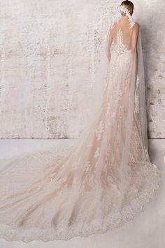 This statement train was made to walk down that aisle. Take their breath away with out amazing MELANIE gown. It's easy to see why brides love her. Click the link for more styles and info.