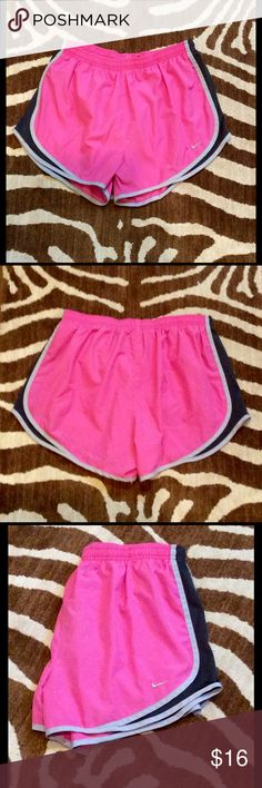 New listing  women's Nike shorts. Cute women's Nike running shorts in size large.  Lightweight fabric, 100% polyester.  Built in brief shorts.  Elastic and drawstring waistband. Pink with dark grey mesh and light grey piping.  Waist measures 4.75 in flat across.  3 in inseam.  Shorts have been lightly worn but are in good condition. Nike Shorts