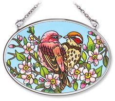 Amia Hand Painted Glass Suncatcher with Lovebird Design, 3-1/4-Inch by 4-1/4-Inch Oval by Amia. $11.00. Handpainted glass. Comes boxed, makes for a great gift. Includes chain. Amia glass is a top selling line of handpainted glass decor. Known for tying in rich colors and excellent designs, Amia has a full line of handpainted glass pieces to satisfy your decor needs. Items in the line range from suncatchers, window decor panels, vases, votives and much more.