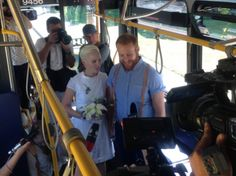 """BUS LOVE. A cute Canadian couple just got married on the same No. 3 bus where they met 16 months ago.  """"I was sitting in the folding accordion-like section when Jarred walked by and sat down a couple metres away from me. We couldn't stop making eye contact. Then he stood up and sat down to the closest available seat to me."""""""