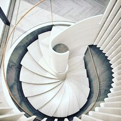 An elegant spiral staircase. Visit houseandleisure.co.za for more