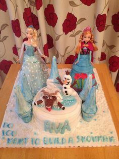 Disney Frozen cake. Elsa and Anna doll cake with Sven and Snowman Olaf.