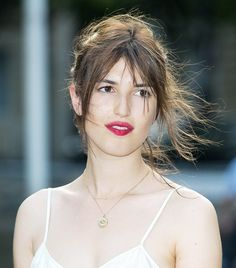 Loving Jeanne Damas's flowing hair and berry-colored lips