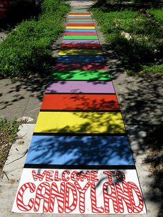 Candy Land Board Game For the Halloween party we threw at the Pink Palace, I created a life-size Candy Land game that guests walked down in order to get into the party