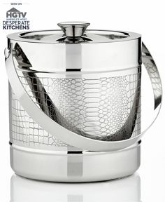 He'll be the king of his castle... er, man cave, when your entertaining spouse serves up cold beverages with the stylish Godinger ice bucket. A stainless steel finish and reptile texture make this unique piece a must have for game night and cocktail parties.