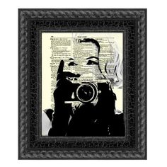 Marilyn Monroe behind the camera - digitally created art printed on a 115 year old antique dictionary page. I like this image of Marilyn