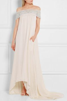 This pretty off-the-shoulder wedding dress is from Self-Portrait. Click to find out why we're SO excited about the brand's expansion into bridal (and pictures of more wedding gowns to obsess over).