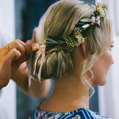 Wedding Updo - This wavy rolled updo would be lovely with or without accessories, but the floral crown makes it fit for a woodland princess | DailyMakeover.com